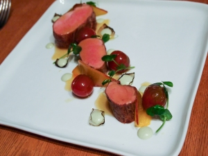 Pork Tenderloin, pea shoots, confit tomatoes, compressed peaches, goat cheese emulsion, pork jus